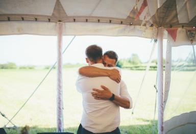 Groom & Best Man Embrace