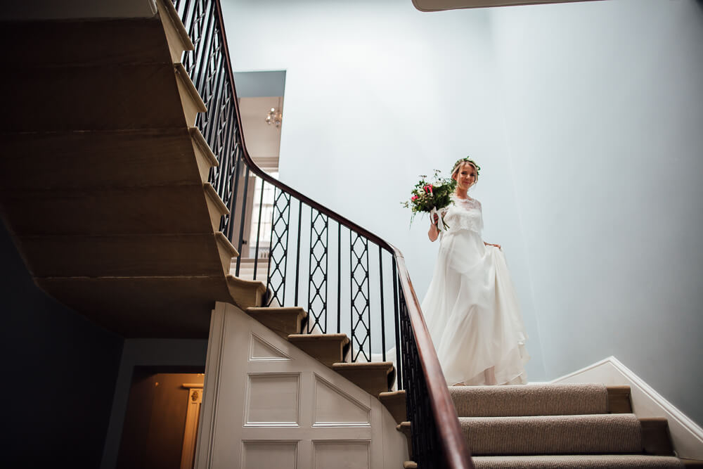 Bride on garthmyl hall staircase