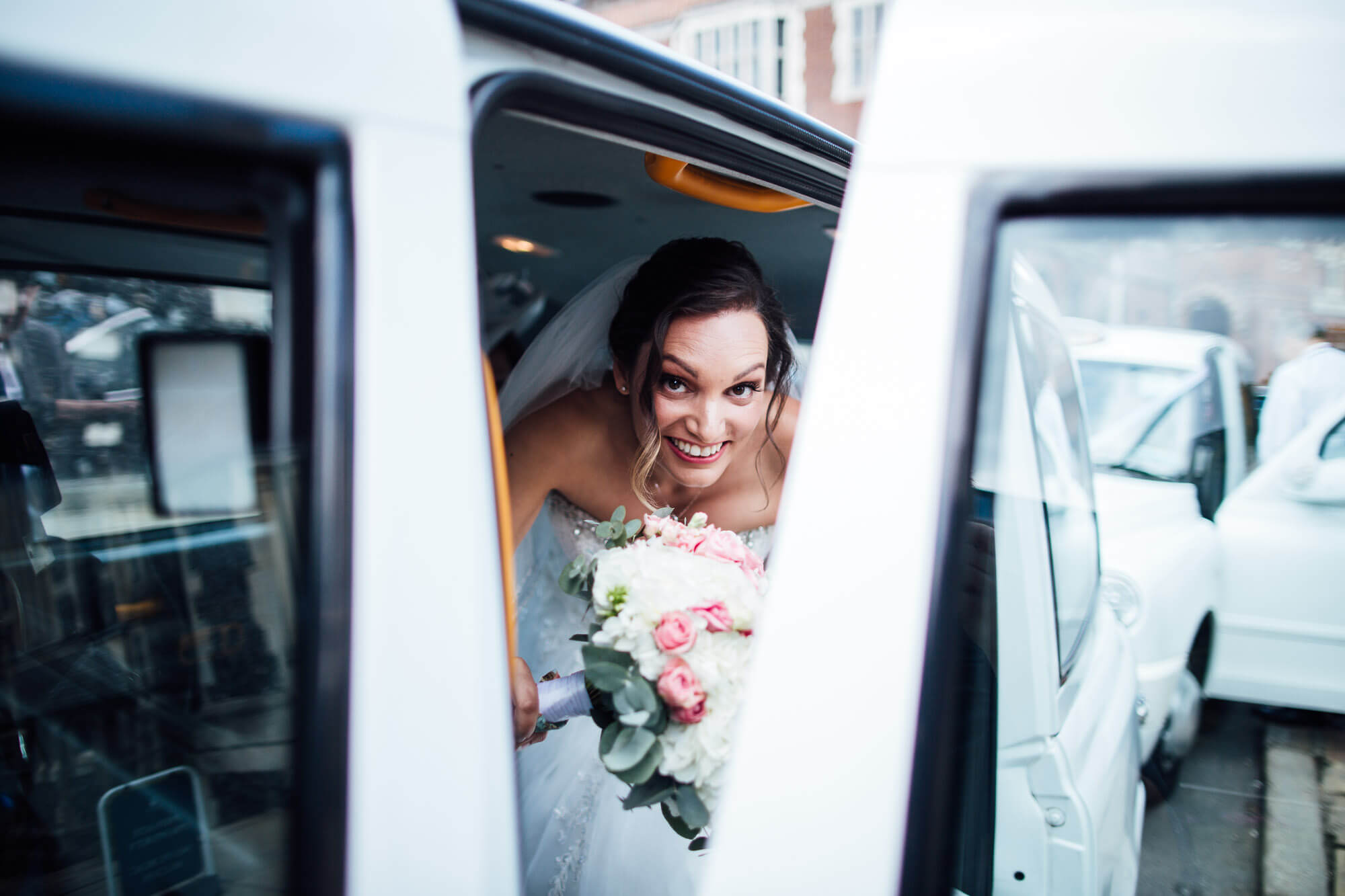 White London Taxi bride