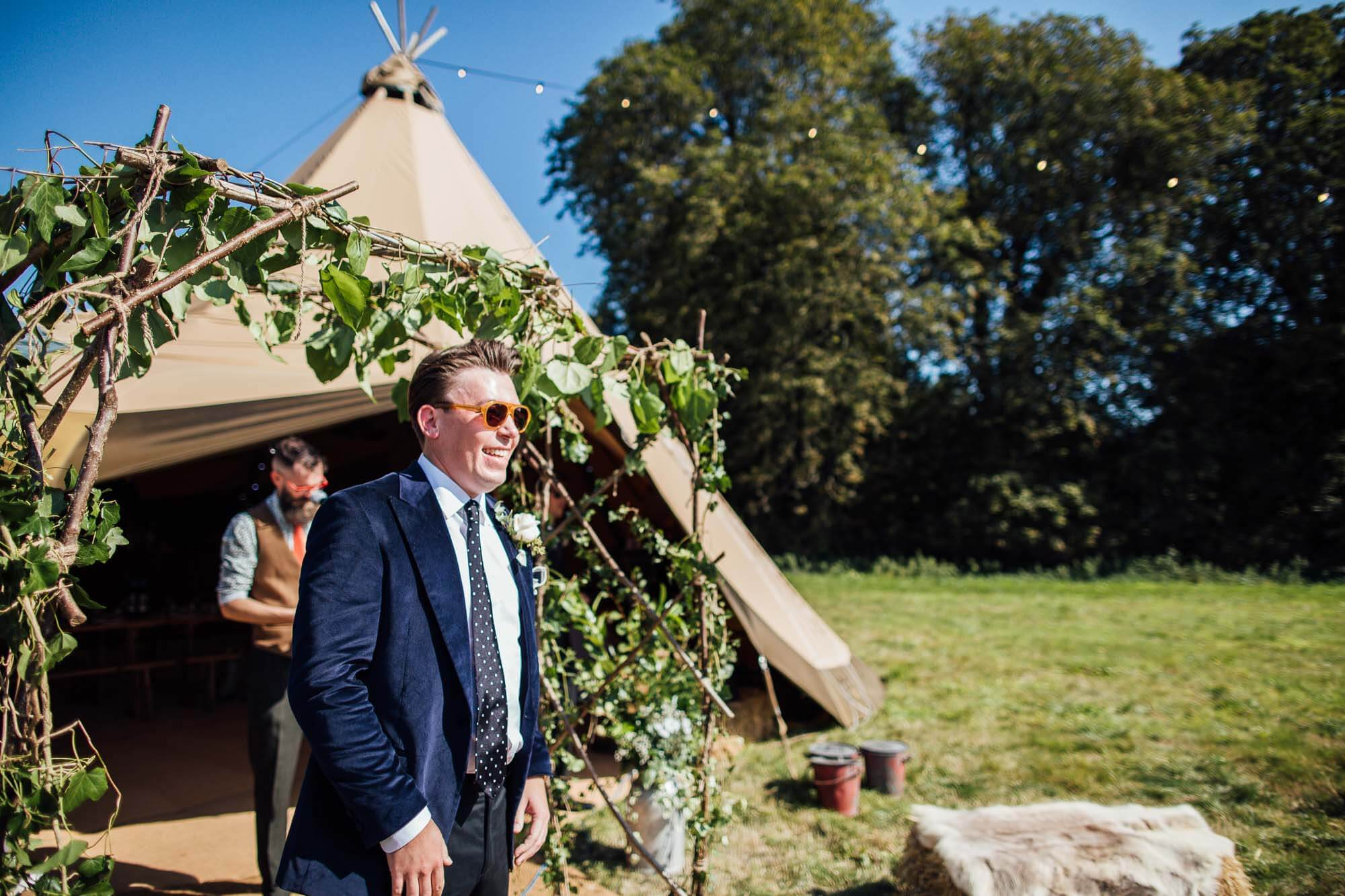 groom outside of tipi