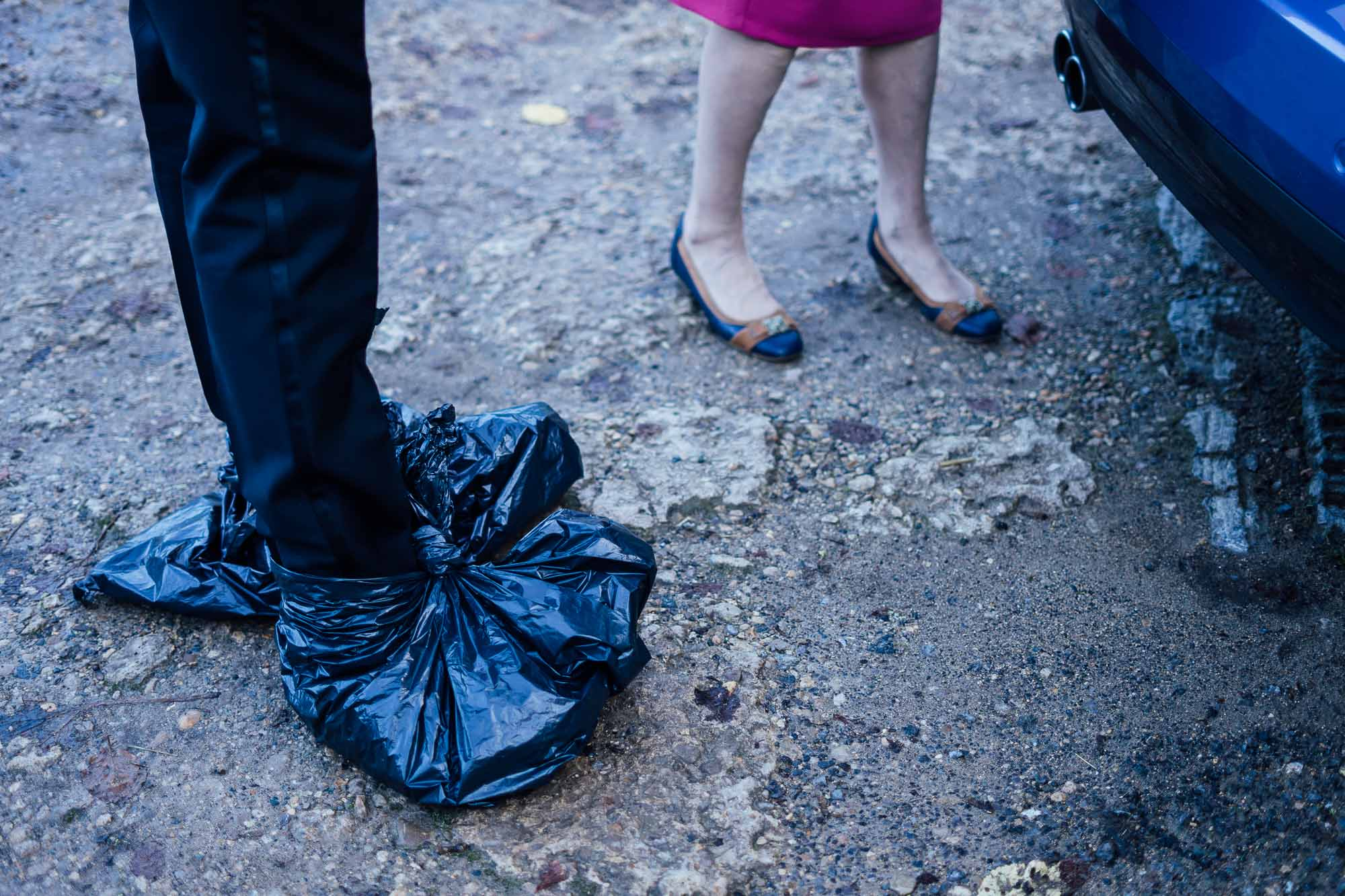 groom with bin bags on shoes