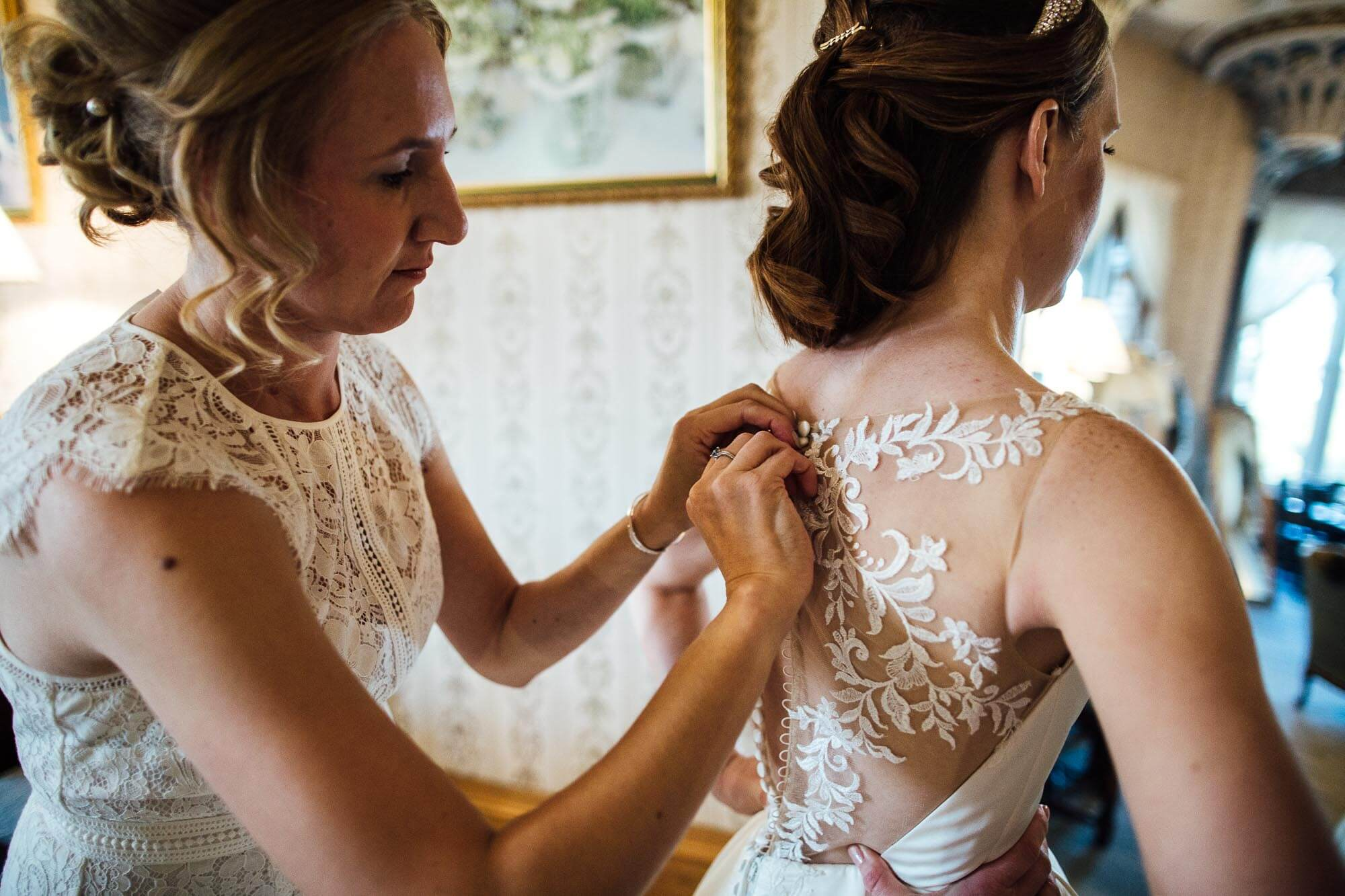 wedding dress being done up